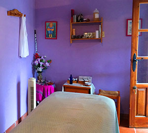 Purple walled massage room at Cortijo Romero