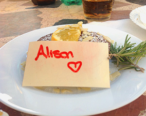 Plate of food with a note saying love Alison