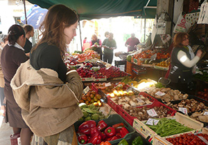 lady looking at fresh fruit and vegetables